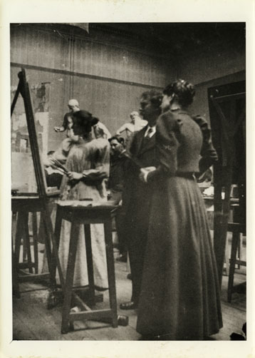 Francis Newbery and Ann Macbeth in painting studio using easels, c1912