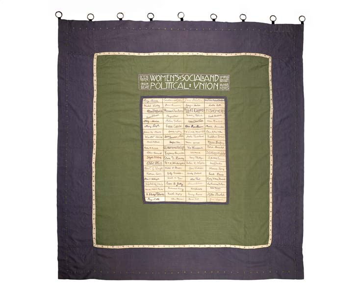 Suffragette banner 'WSPU Holloway Prisoners',  1910. It includes the embroidered signatures of 80 suffragette hunger-strikers who had 'faced death without flinching'. Made in the style of a traditional friendship quilt it symbolises the spirit of comradeship that gave suffragette prisoners the strength and courage to endure hunger strike and force feeding.