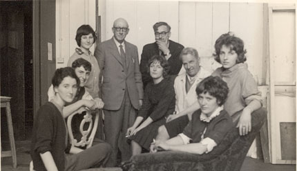 Photograph of Wilson Steel, Librarian, and Ted Odling with a group of students (Jenny Stead, Jenny Stevenson, Willie Armour, Ann Ferguson, Colette Connolly, Mary Cameron), c1950s. (Archive Reference: GSAA/P/1/50)