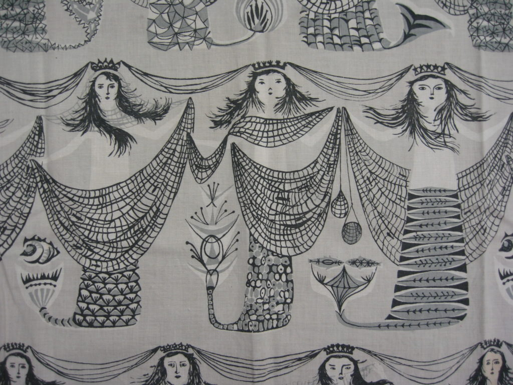 Mermaids textile design by Margaret Stewart is available to buy as a tea towel or a cushion from Centre for Advanced Textiles (Archive Reference: DC 075/9)